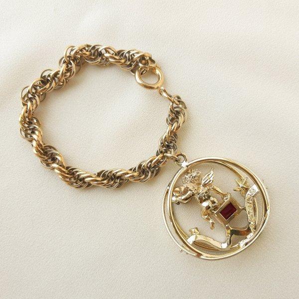 Винтажный чарм - браслет с ангелом «Июль» от Coro Купить антиквариат
