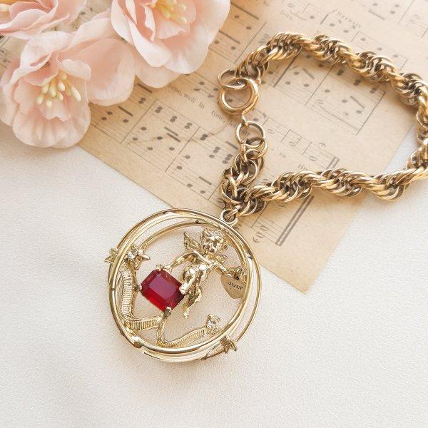 Винтажный чарм - браслет с ангелом «Июль» от Coro Купить винтаж